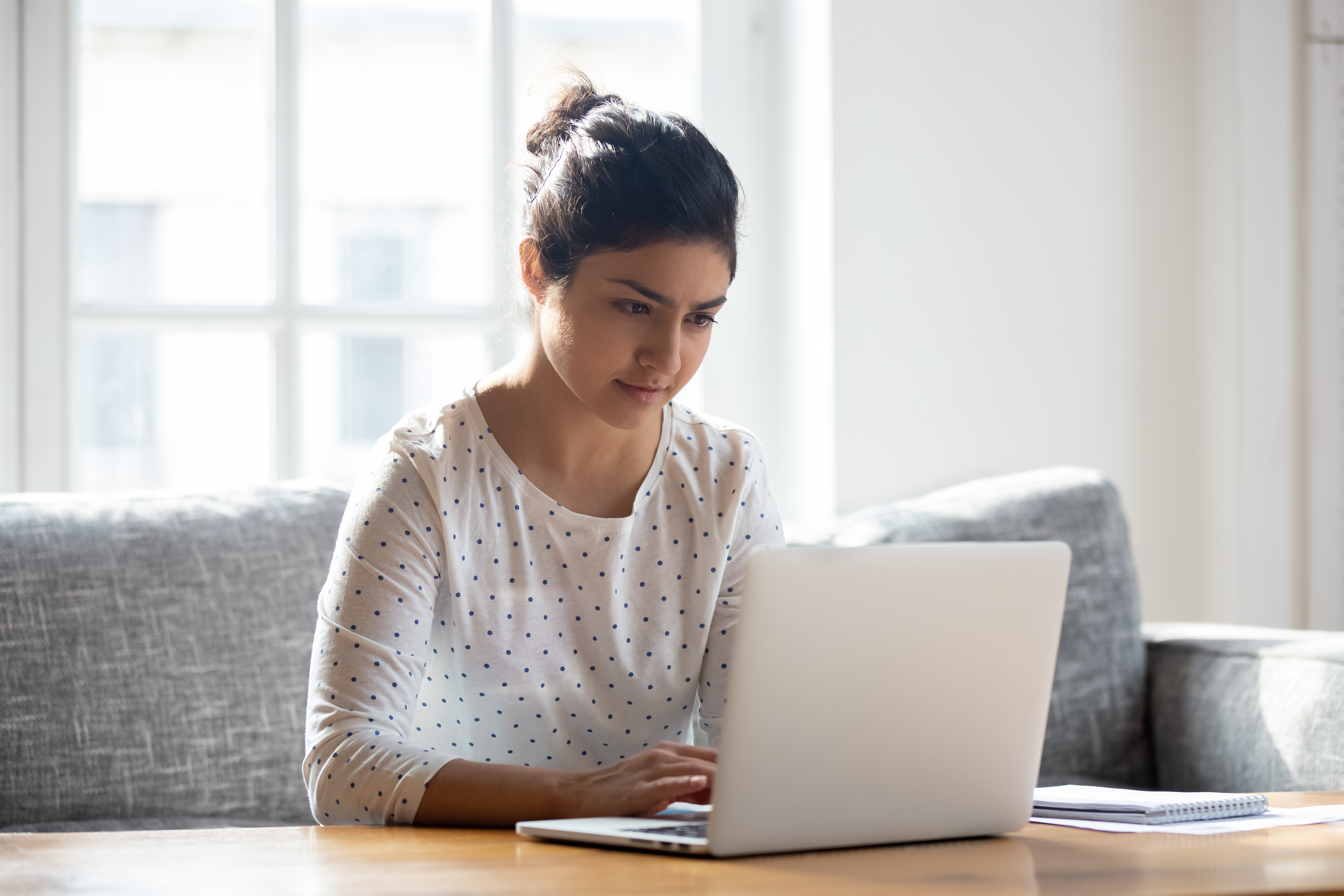 Woman freelancer mom student at home working on laptop